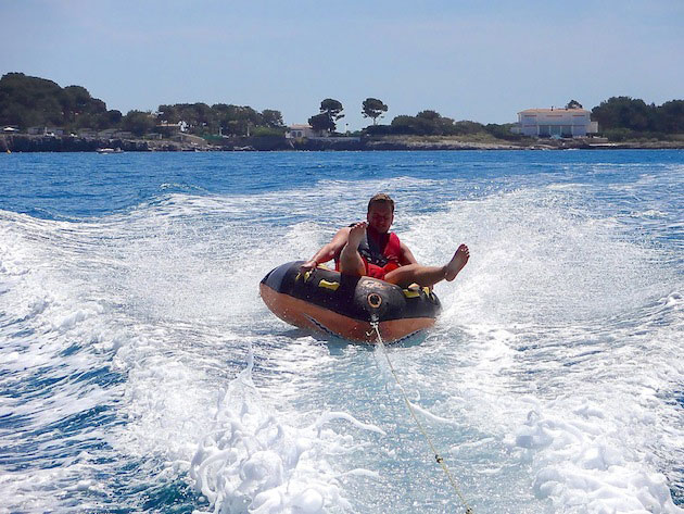 Race along behind your boat on an inflatable donut