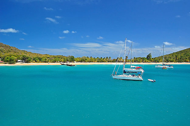 A peaceful charter yacht anchorage at Canouan Island, St Vincent and the Grenadines
