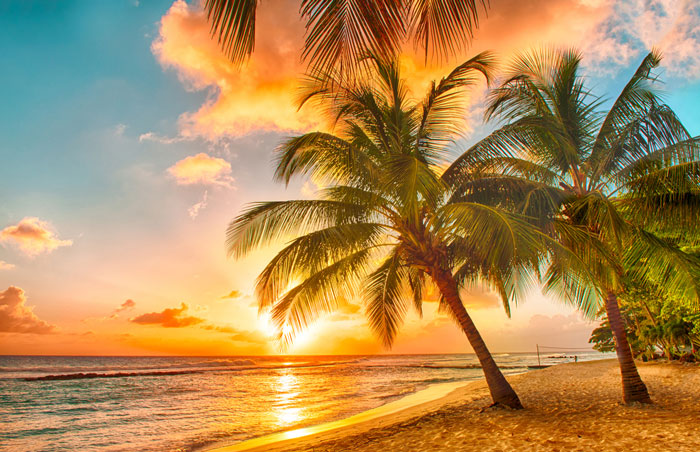 The sun sets over the beach in Barbados