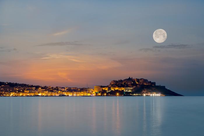 The sun setting over Calvi in Corsica