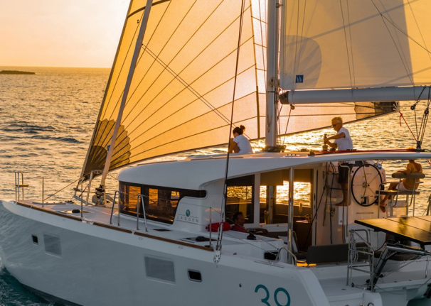 Sail off into the sunset on your catamaran charter with Boatbookings.com
