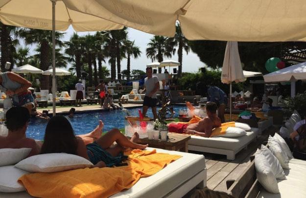 Relaxin the warmth pool side in St Tropez
