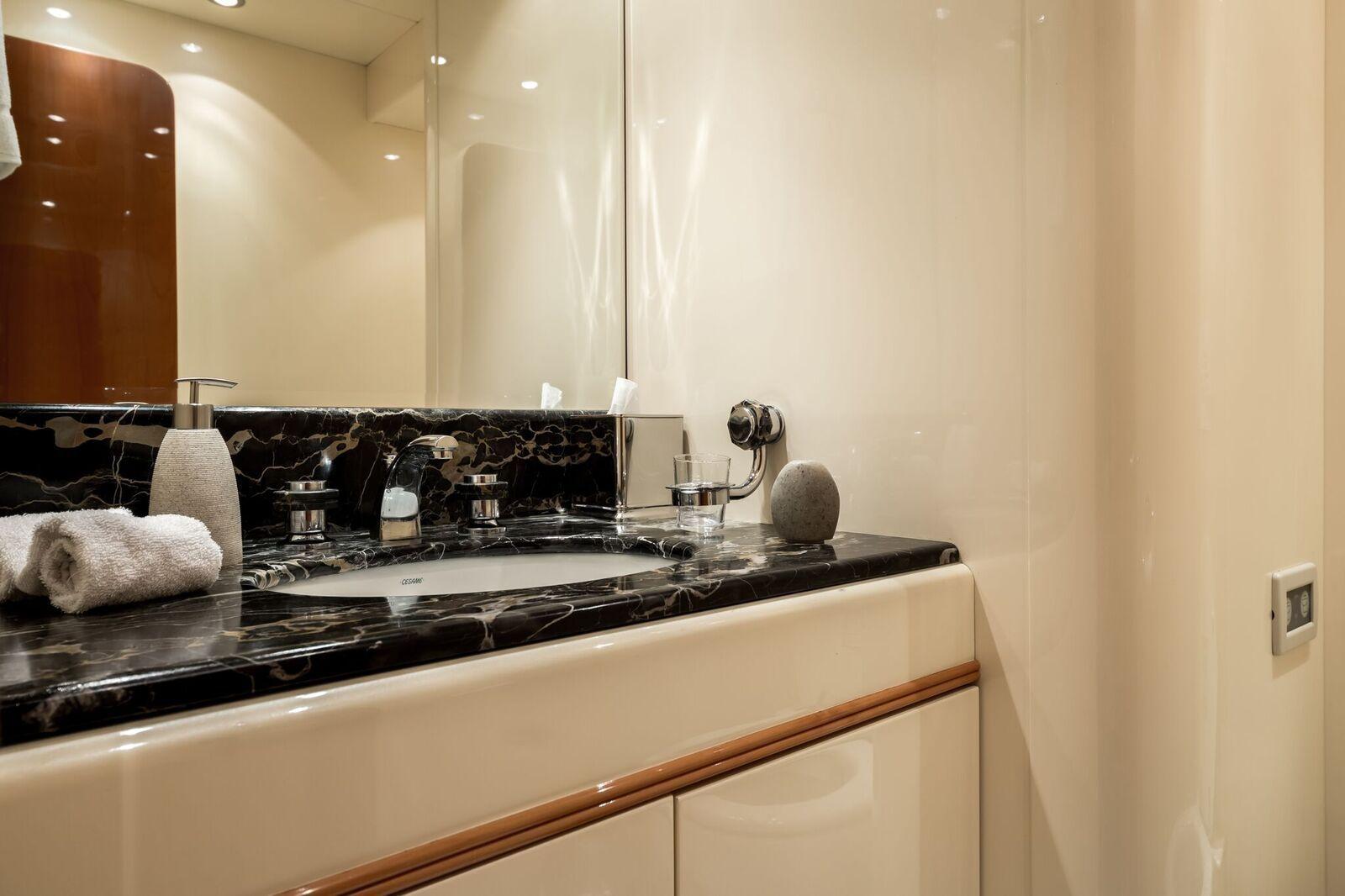 INDULGENCE OF POOLE Mangusta 86 Luxury Superyacht Main Bathroom